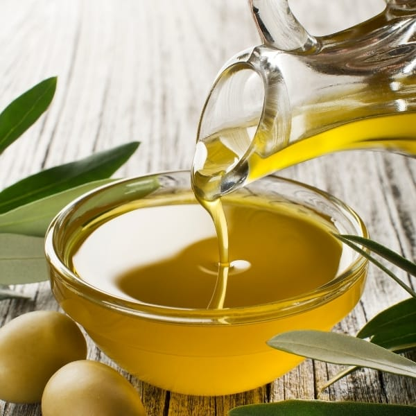 photo of olive oil being poured into glass bowl representing Frantoio Extra Virgin Olive Oil