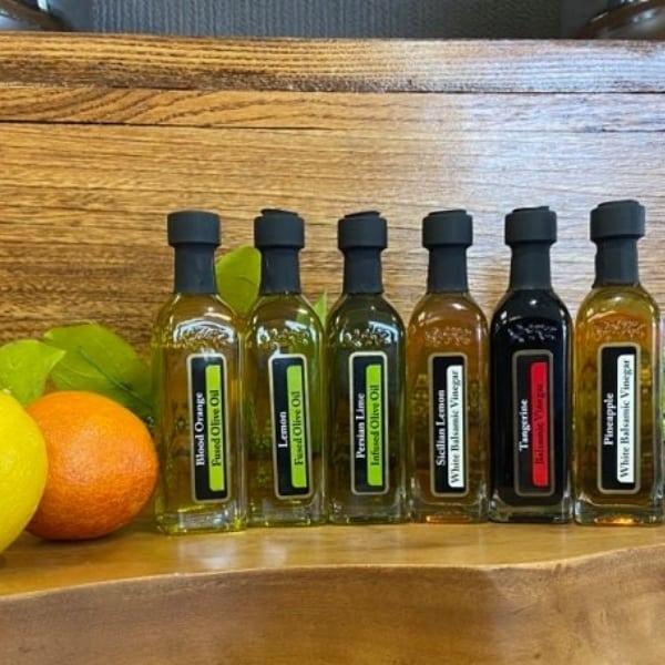 OV Harvest citrus sampler featuring Blood Orange Olive Oil, Eureka Lemon Olive Oil, Persian Lime Olive Oil, Tangerine Balsamic, Pineapple Balsamic & Sicilian Lemon Balsamic