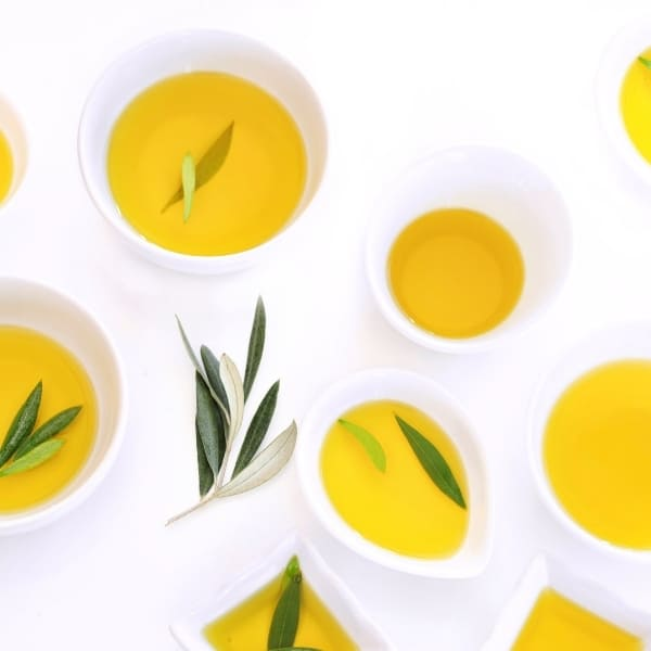 """photo of bowls of olive oil scattered representing """"Oro Bailen"""" Picual Extra Virgin Olive Oil"""