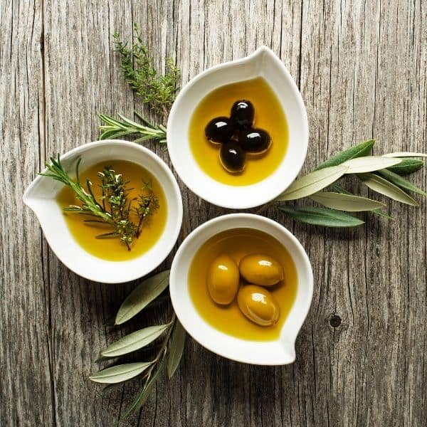 photo of three white bowls of olive oil representing galega extra virgin olive oil