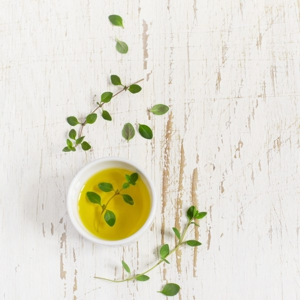 photo of small bowl of olive oil representing pendolino extra virgin olive oil