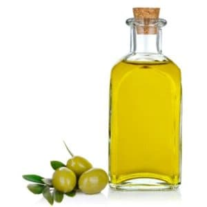 photo of jar of olive oil with olives representing picual extra virgin olive oil