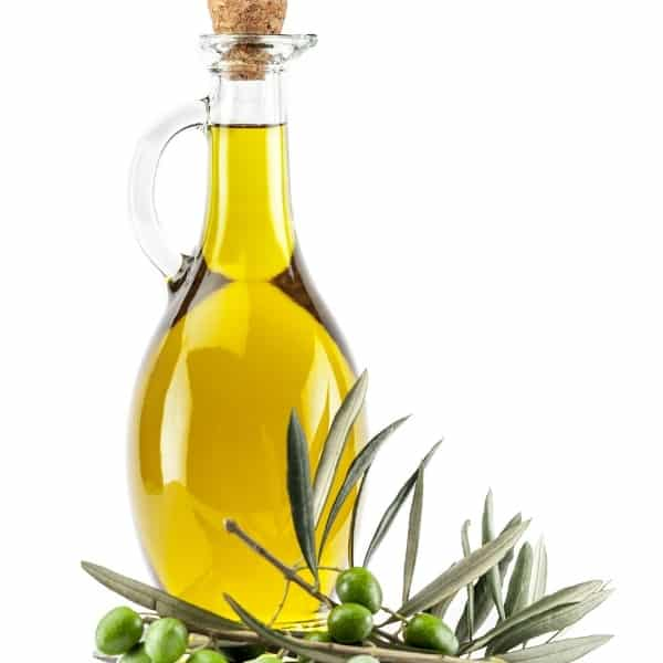 photo of bottle of olive oil with olives and leaves representing cerasuola extra virgin olive oil