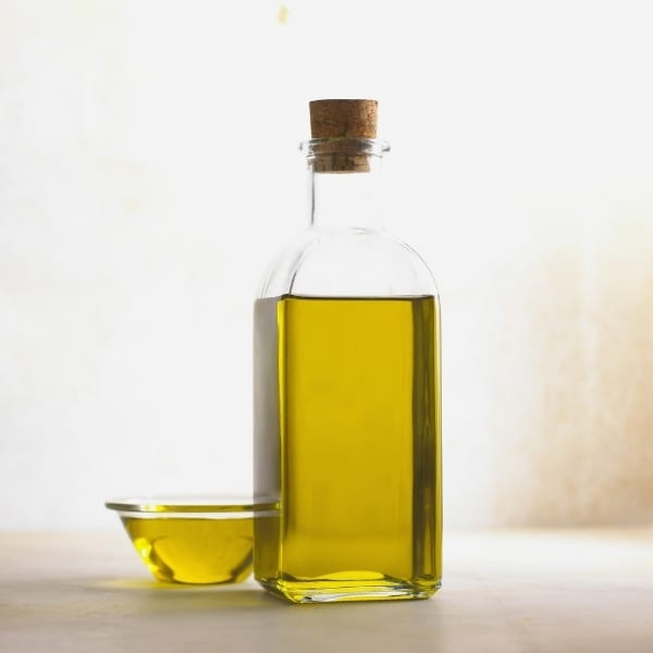photo of bottle of olive oil and glass bowl of olive oil representing Cuvee extra virgin olive oil