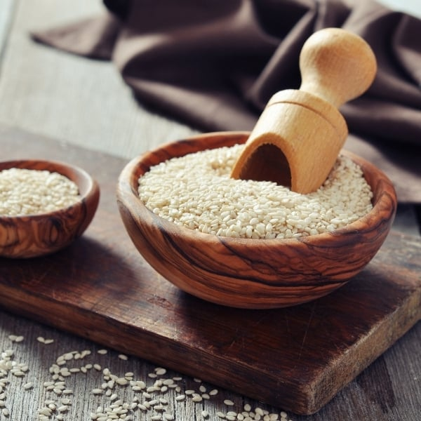 photo of bowl of sesame seeds with scoop representing Japanese sesame oil
