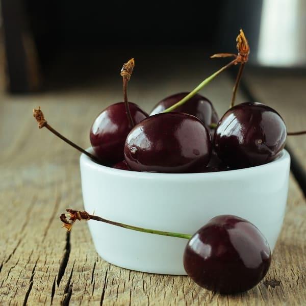photo of black cherries in bowl representing black cherry balsamic vinegar