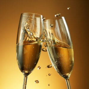 photo of two glasses of champagne clinking together representing champagne vinegar
